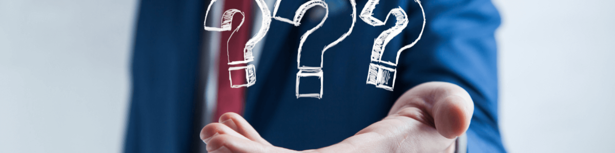 Man holding question marks