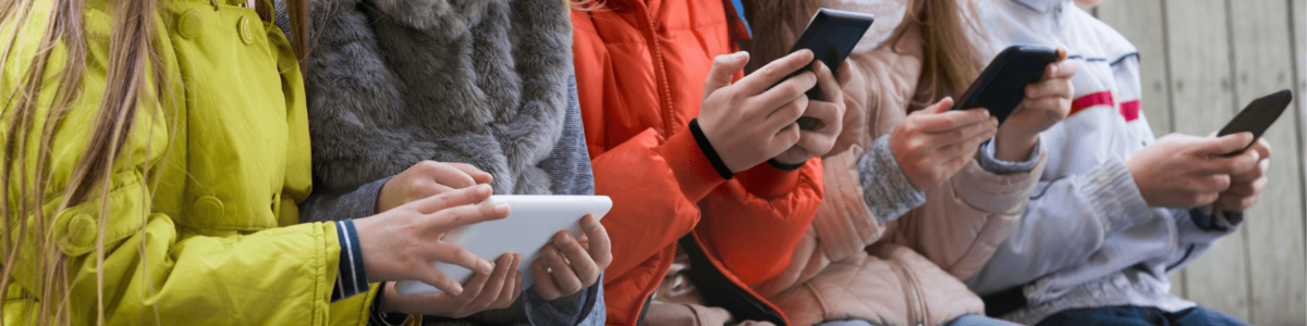 Multiple people using mobiles and other devices