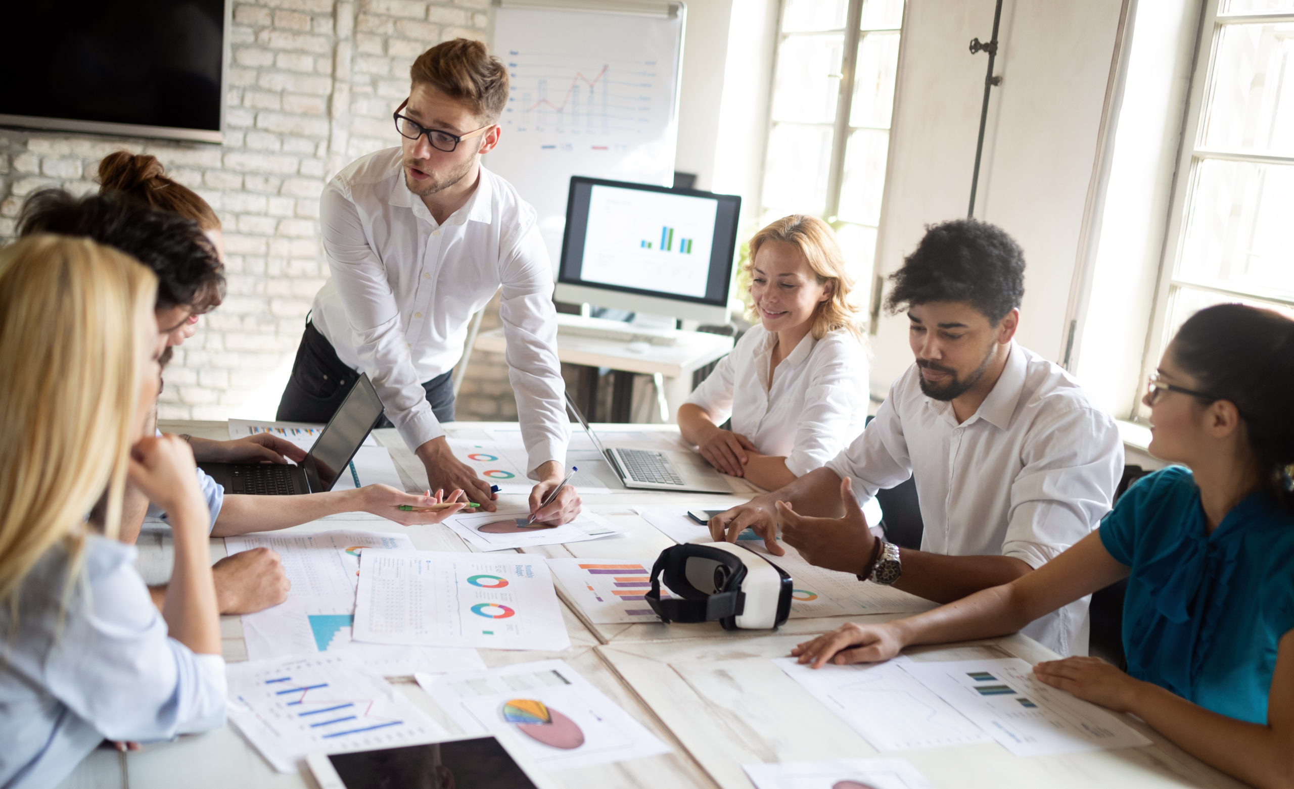 Business, technology and people concept - creative team or designers working in office