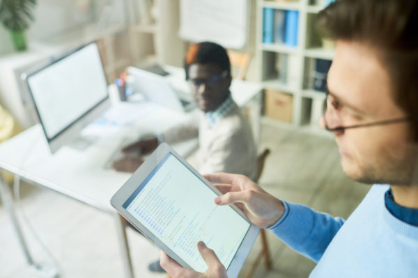 Web Developer Holding Tablet