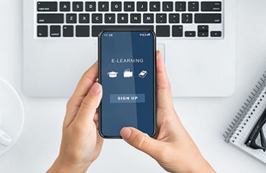 Online Education Concept. Above top view of female student using smartphone with educational website, ready to sign up for virtual classroom and to watch webinar. E-learning, study and stay at home